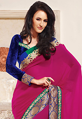 Let your personality articulate for you with this amazing embroidered saree. This dark pink faux georgette saree is nicely designed with embroidered patch work is done with resham and zari work. This saree gives you a modern and different look in fabulous style. Contrasting dark blue velvet blouse is available. Slight color variations are possible due to differing screen and photograph resolution.
