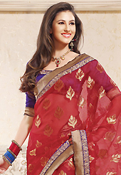 Get ready to sizzle all around you by sparkling saree. This red silk saree is nicely designed with embroidered patch work is done with zari work. This saree gives you a modern and different look in fabulous style. Contrasting purple blouse is available. Slight color variations are possible due to differing screen and photograph resolution.