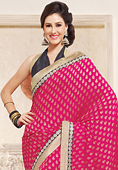 The most beautiful refinements for style and tradition. This dark pink viscose georgette saree is nicely designed with embroidered patch work is done with zari and sequins work. This saree gives you a modern and different look in fabulous style. Contrasting black blouse is available. Slight color variations are possible due to differing screen and photograph resolution.