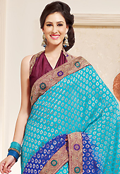 The traditional patterns used on this saree maintain the ethnic look. This shaded light blue and dark blue viscose georgette saree is nicely designed with embroidered patch work is done with resham work. This saree gives you a modern and different look in fabulous style. Contrasting burgundy blouse is available. Slight color variations are possible due to differing screen and photograph resolution.