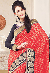 Take a look on the changing fashion of the season. This coral viscose georgette saree is nicely designed with embroidered patch work is done with zari and lace work. This saree gives you a modern and different look in fabulous style. Contrasting black blouse is available. Slight color variations are possible due to differing screen and photograph resolution.