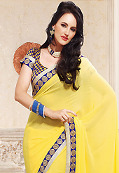 Ultimate collection of embroidery sarees with fabulous style. This yellow faux georgette saree is nicely designed with embroidered patch work is done with zari and stone work. This saree gives you a modern and different look in fabulous style. Matching blouse is available. Slight color variations are possible due to differing screen and photograph resolution.