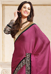 Welcome to the new era of Indian fashion wear. This deep pink satin saree is nicely designed with embroidered patch work is done with zari and lace work. This saree gives you a modern and different look in fabulous style. Contrasting black blouse is available. Slight color variations are possible due to differing screen and photograph resolution.