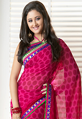 Try out this year top trend, glowing, bold and natural collection. This shaded dark pink georgette saree is nicely designed with polka dots print, zari and patch bordered work. Beautiful embroidery work on saree make attractive to impress all. This saree gives you a modern and different look in fabulous style. Matching blouse is available. Slight color variations are possible due to differing screen and photograph resolution.