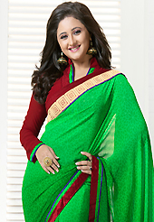 Ultimate collection of embroidery sarees with fabulous style. This shaded green georgette saree is nicely designed with floral print and patch bordered work. Beautiful embroidery work on saree make attractive to impress all. This saree gives you a modern and different look in fabulous style. Contrasting maroon blouse is available. Slight color variations are possible due to differing screen and photograph resolution.
