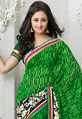 Get ready to sizzle all around you by sparkling saree. This green and black georgette saree is nicely designed with floral, abstract print, zari, lace and patch bordered work. Beautiful embroidery work on saree make attractive to impress all. This saree gives you a modern and different look in fabulous style. Matching blouse is available. Slight color variations are possible due to differing screen and photograph resolution.