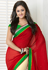 Let your personality articulate for you with this amazing printes saree. This red and cream georgette jacquard saree is nicely designed with floral, abstract print, stone and patch bordered work. Beautiful embroidery work on saree make attractive to impress all. This saree gives you a modern and different look in fabulous style. Contrasting green blouse is available. Slight color variations are possible due to differing screen and photograph resolution.