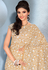 Get ready to sizzle all around you by sparkling saree. This beautiful light fawn and white cotton saree is nicely designed with floral print work. It will enhance your personality and gives you a singular look. Matching blouse is available with this saree. Slight color variations are due to differing screen and photography resolution.