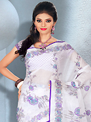 The traditional patterns used on this saree maintain the ethnic look. This beautiful white cotton saree is nicely designed with floral and stripe print work. It will enhance your personality and gives you a singular look. Matching blouse is available with this saree. Slight color variations are due to differing screen and photography resolution.