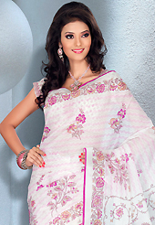 Ultimate collection of embroidered sarees with fabulous style. This beautiful off white cotton saree is nicely designed with floral print work. It will enhance your personality and gives you a singular look. Matching blouse is available with this saree. Slight color variations are due to differing screen and photography resolution.