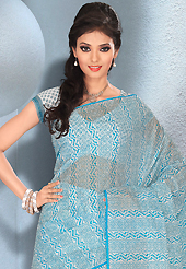 Take the fashion industry by storm in this beautiful printed saree. This beautiful sky blue and off white cotton saree is nicely designed with abstract and floral print work. It will enhance your personality and gives you a singular look. Matching blouse is available with this saree. Slight color variations are due to differing screen and photography resolution.