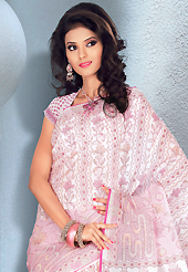Printed sarees are the best choice for a girl to enhance her feminine look. This beautiful white and pink cotton saree is nicely designed with abstract and floral print work. It will enhance your personality and gives you a singular look. Matching blouse is available with this saree. Slight color variations are due to differing screen and photography resolution.