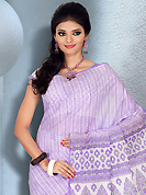 The most radiant carnival of style and beauty. This beautiful white and light purple cotton saree is nicely designed with abstract and floral print work. It will enhance your personality and gives you a singular look. Matching blouse is available with this saree. Slight color variations are due to differing screen and photography resolution.