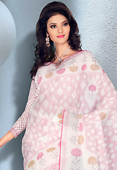 Try out this year top trend, glowing, bold and natural collection. This beautiful off white and pink cotton saree is nicely designed with geometric and floral print work. It will enhance your personality and gives you a singular look. Matching blouse is available with this saree. Slight color variations are due to differing screen and photography resolution.