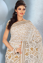 An occasion wear perfect is ready to rock you. This beautiful off white, fawn and grey cotton saree is nicely designed with floral and abstract print work. It will enhance your personality and gives you a singular look. Matching blouse is available with this saree. Slight color variations are due to differing screen and photography resolution.