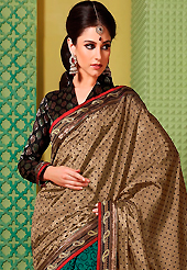 An endearing splash oh colors look gorgeous tridimensional charm. This dusty fawn and green art silk saree is nicely designed with dot, floral, foil print, self weaving zari and patch bordered work. Beautiful embroidery work on saree make attractive to impress all. This saree gives you a modern and different look in fabulous style. Contrasting black blouse is available. Slight color variations are possible due to differing screen and photograph resolution.
