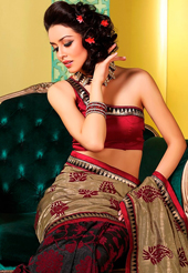 Get ready to sizzle all around you by sparkling saree. This dusty fawn, black and maroon art silk saree is nicely designed with abstract print and embroidered patch work is done with resham and self weaving zari work. Beautiful embroidery work on saree make attractive to impress all. This saree gives you a modern and different look in fabulous style. Matching blouse is available. Slight color variations are possible due to differing screen and photograph resolution.