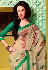Style and trend will be at the peak of your beauty when you adorn this saree. This light fawn art silk saree is nicely designed with floral, abstract print, lace and patch work. Beautiful embroidery work on saree make attractive to impress all. This saree gives you a modern and different look in fabulous style. Contrasting green blouse is available. Slight color variations are possible due to differing screen and photograph resolution.
