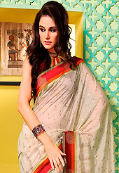 Take the fashion industry by storm in this beautiful embroidered saree. This off white art silk saree is nicely designed with foil print and patch bordered work. Beautiful embroidery work on saree make attractive to impress all. This saree gives you a modern and different look in fabulous style. Contrasting maroon blouse is available. Slight color variations are possible due to differing screen and photograph resolution.