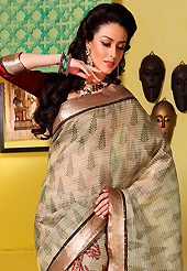 Embroidered sarees are the best choice for a girl to enhance her feminine look. This beige art silk saree is nicely designed with floral, abstract, stripe print and self weaving zari patch bordered work. Beautiful embroidery work on saree make attractive to impress all. This saree gives you a modern and different look in fabulous style. Contrasting maroon blouse is available. Slight color variations are possible due to differing screen and photograph resolution.