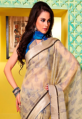 An occasion wear perfect is ready to rock you. This beige art silk saree is nicely designed with floral, abstract, stripe print and self weaving zari patch bordered work. Beautiful embroidery work on saree make attractive to impress all. This saree gives you a modern and different look in fabulous style. Contrasting blue blouse is available. Slight color variations are possible due to differing screen and photograph resolution.