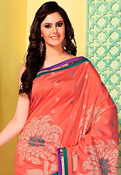 An occasion wear perfect is ready to rock you. This coral art silk saree is nicely designed with floral print, self weaving zari and patch bordered work. Beautiful embroidery work on saree make attractive to impress all. This saree gives you a modern and different look in fabulous style. Matching blouse is available. Slight color variations are possible due to differing screen and photograph resolution.
