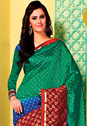 The traditional patterns used on this saree maintain the ethnic look. This green, blue and maroon art silk saree is nicely designed with floral print, self weaving zari, resham and patch bordered work. Beautiful embroidery work on saree make attractive to impress all. This saree gives you a modern and different look in fabulous style. Matching blouse is available. Slight color variations are possible due to differing screen and photograph resolution.