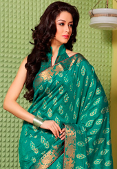Make a trendy look with this classic embroidered saree. This teal green art silk saree is nicely designed with floral print, self weaving zari and patch bordered work. Beautiful embroidery work on saree make attractive to impress all. This saree gives you a modern and different look in fabulous style. Matching blouse is available. Slight color variations are possible due to differing screen and photograph resolution.