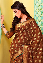 You can be sure that ethnic fashions selections of clothing are taken from the latest trend in today's fashion. This brown art silk saree is nicely designed with floral print, self weaving zari and patch bordered work. Beautiful embroidery work on saree make attractive to impress all. This saree gives you a modern and different look in fabulous style. Matching blouse is available. Slight color variations are possible due to differing screen and photograph resolution.