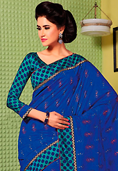 Style and trend will be at the peak of your beauty when you adorn this saree. This royal blue art silk saree is nicely designed with floral, polka dots print, self weaving zari and patch bordered work. Beautiful embroidery work on saree make attractive to impress all. This saree gives you a modern and different look in fabulous style. Contrasting turquoise green blouse is available. Slight color variations are possible due to differing screen and photograph resolution.