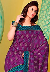 Welcome to the new era of Indian fashion wear. This dark magenta art silk saree is nicely designed with floral, polka dots print, self weaving zari and patch bordered work. Beautiful embroidery work on saree make attractive to impress all. This saree gives you a modern and different look in fabulous style. Contrasting turquoise green blouse is available. Slight color variations are possible due to differing screen and photograph resolution.