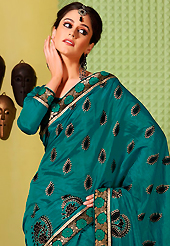 Embroidered sarees are the best choice for a girl to enhance her feminine look. This teal green art silk saree is nicely designed with foil print, self weaving zari and patch bordered work. Beautiful embroidery work on saree make attractive to impress all. This saree gives you a modern and different look in fabulous style. Matching blouse is available. Slight color variations are possible due to differing screen and photograph resolution.