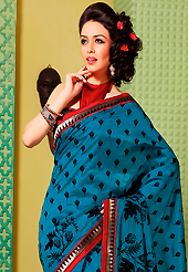 It is color this season and bright shaded suits are really something that is totally in vogue. This teal blue art silk saree is nicely designed with floral print, self weaving zari and patch bordered work. Beautiful embroidery work on saree make attractive to impress all. This saree gives you a modern and different look in fabulous style. Contrasting red blouse is available. Slight color variations are possible due to differing screen and photograph resolution.