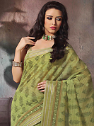 Era with extension in fashion, style, Grace and elegance have developed grand love affair with this ethnical wear. This beautiful green cotton saree is nicely designed with floral, abstract print and self weaving zari work. Beautiful print work on saree make attractive to impress all. It will enhance your personality and gives you a singular look. Matching blouse is available with this saree. Slight color variations are due to differing screen and photography resolution.