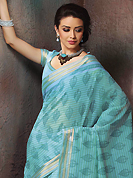 Get ready to sizzle all around you by sparkling saree. This beautiful blue cotton saree is nicely designed with floral, abstract print and self weaving zari work. Beautiful print work on saree make attractive to impress all. It will enhance your personality and gives you a singular look. Matching blouse is available with this saree. Slight color variations are due to differing screen and photography resolution.