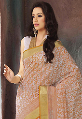 Keep the interest with this printed saree. This beautiful off white and light orange cotton saree is nicely designed with paisley, abstract print and self weaving zari work. Beautiful print work on saree make attractive to impress all. It will enhance your personality and gives you a singular look. Matching blouse is available with this saree. Slight color variations are due to differing screen and photography resolution.