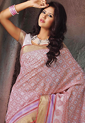 Make a trendy look with this classic printed saree. This beautiful off white and pink cotton saree is nicely designed with floral, abstract, geometric print and self weaving zari work. Beautiful print work on saree make attractive to impress all. It will enhance your personality and gives you a singular look. Matching blouse is available with this saree. Slight color variations are due to differing screen and photography resolution.