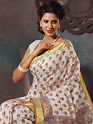 You can be sure that ethnic fashions selections of clothing are taken from the latest trend in today's fashion. This beautiful off white and brown cotton saree is nicely designed with floral, paisley, abstract print and self weaving zari work. Beautiful print work on saree make attractive to impress all. It will enhance your personality and gives you a singular look. Matching blouse is available with this saree. Slight color variations are due to differing screen and photography resolution.