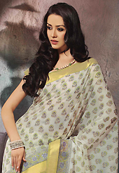 Style and trend will be at the peak of your beauty when you adorn this saree. This beautiful off white and green cotton saree is nicely designed with floral, abstract print and self weaving zari work. Beautiful print work on saree make attractive to impress all. It will enhance your personality and gives you a singular look. Matching blouse is available with this saree. Slight color variations are due to differing screen and photography resolution.