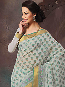 Ultimate collection of embroidered sarees with fabulous style. This beautiful off white and green cotton saree is nicely designed with floral, abstract print and self weaving zari work. Beautiful print work on saree make attractive to impress all. It will enhance your personality and gives you a singular look. Matching blouse is available with this saree. Slight color variations are due to differing screen and photography resolution.