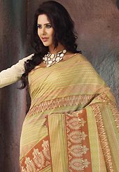 Take the fashion industry by storm in this beautiful printed saree. This beautiful yellow, rust and green cotton saree is nicely designed with stripe, abstract print and self weaving zari work. Beautiful print work on saree make attractive to impress all. It will enhance your personality and gives you a singular look. Matching blouse is available with this saree. Slight color variations are due to differing screen and photography resolution.