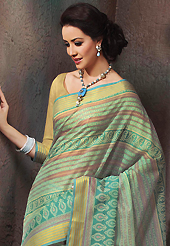 Printed sarees are the best choice for a girl to enhance her feminine look. This beautiful sea green and turquoise green cotton saree is nicely designed with stripe, floral, abstract print and self weaving zari work. Beautiful print work on saree make attractive to impress all. It will enhance your personality and gives you a singular look. Matching blouse is available with this saree. Slight color variations are due to differing screen and photography resolution.