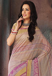 It is color this season and bright shaded suits are really something that is totally in vogue. This beautiful dark cream and pink cotton saree is nicely designed with stripe, geometric, abstract print and self weaving zari work. Beautiful print work on saree make attractive to impress all. It will enhance your personality and gives you a singular look. Matching blouse is available with this saree. Slight color variations are due to differing screen and photography resolution.