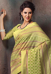 Dreamy variation on shape and forms compliment your style with tradition. This beautiful green and dark cream cotton saree is nicely designed with stripe, floral, abstract print and self weaving zari work. Beautiful print work on saree make attractive to impress all. It will enhance your personality and gives you a singular look. Matching blouse is available with this saree. Slight color variations are due to differing screen and photography resolution.