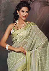 An occasion wear perfect is ready to rock you. This beautiful off white and light green cotton saree is nicely designed with abstract print and self weaving zari work. Beautiful print work on saree make attractive to impress all. It will enhance your personality and gives you a singular look. Matching blouse is available with this saree. Slight color variations are due to differing screen and photography resolution.