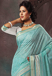 A desire that evokes a sense of belonging with a striking details. This beautiful sky blue and off white cotton saree is nicely designed with abstract print and self weaving zari work. Beautiful print work on saree make attractive to impress all. It will enhance your personality and gives you a singular look. Matching blouse is available with this saree. Slight color variations are due to differing screen and photography resolution.