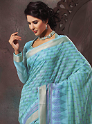 Get ready to sizzle all around you by sparkling saree. This beautiful sky blue cotton saree is nicely designed with paisley, abstract, geometric print and self weaving zari work. Beautiful print work on saree make attractive to impress all. It will enhance your personality and gives you a singular look. Matching blouse is available with this saree. Slight color variations are due to differing screen and photography resolution.
