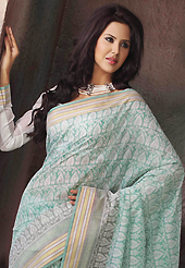 The traditional patterns used on this saree maintain the ethnic look. This beautiful off white and sky blue cotton saree is nicely designed with abstract print and self weaving zari work. Beautiful print work on saree make attractive to impress all. It will enhance your personality and gives you a singular look. Matching blouse is available with this saree. Slight color variations are due to differing screen and photography resolution.