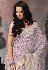 Keep the interest with this printed saree. This beautiful off white and lavender cotton saree is nicely designed with abstract print and self weaving zari work. Beautiful print work on saree make attractive to impress all. It will enhance your personality and gives you a singular look. Matching blouse is available with this saree. Slight color variations are due to differing screen and photography resolution.