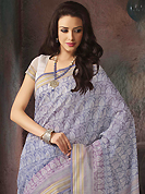 The most radiant carnival of style and beauty. This beautiful off white and blue cotton saree is nicely designed with abstract print and self weaving zari work. Beautiful print work on saree make attractive to impress all. It will enhance your personality and gives you a singular look. Matching blouse is available with this saree. Slight color variations are due to differing screen and photography resolution.